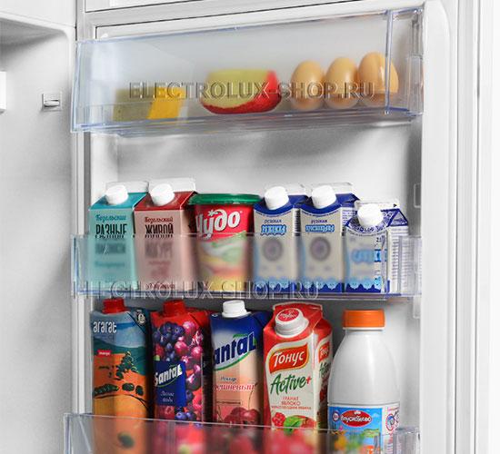 Дверные полки двухкамерного холодильника Electrolux EN 3454 NOW